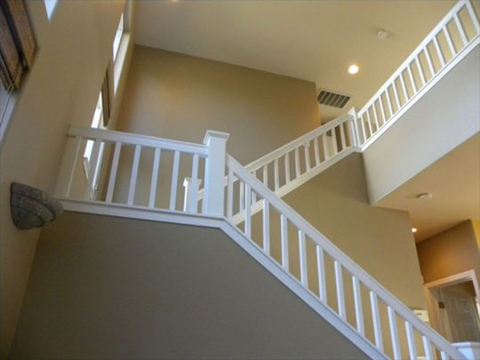 Staircase with vaulted ceiling